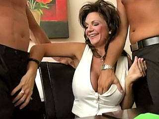 Bosomy brunette getting screwed hard by two guys at dissimulate