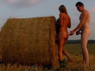 Nubiles strip by the stack of hay in order to start sex games